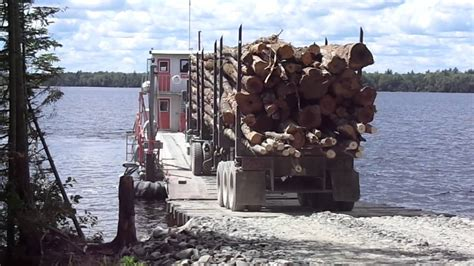 2013 loaded logging truck driving on to barge on Moosehead