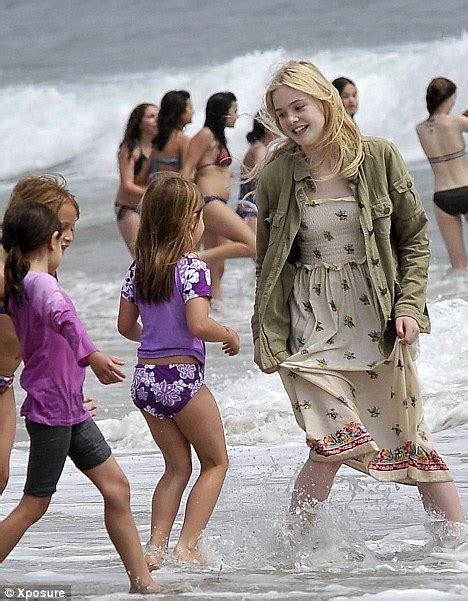 Dakota Fanning and sister Elle have a blast at LA beach
